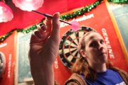 Erin Adams, of Lawrence, demonstrates her dart-throwing form at The Red Lyon, 944 Mass. Adams is secretary of the Lawrence Dart Association and has participated for 14 years.
