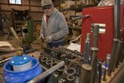 Thurman Duncan of De Soto likes to take apart old John Deere tractors and restore them to an almost new look. He is very creful about putting all his tools back onto his tool table so he can easily find them.