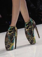 A model presents Lobster claw shoes, a creation by British fashion designer Alexander McQueen, in this Oct. 6, 2009, file photo. McQueen was found dead at his London home on Thursday, his spokeswoman said. He was 40 years old.