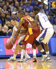 Kansas guard Tyrel Reed (14) and guard Elijah Johnson (15) pressure Iowa State forward Craig Brackins (21) Saturday, Feb. 13, 2010 at Allen Fieldhouse.