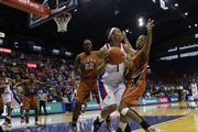 Texas' Brittainey Raven (right) pressures KU sophomore Aishah Sutherland (1) in overtime Saturday, Feb. 13, 2010 at Allen Fieldhouse.