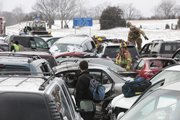 Emergency personnel work the scene of  a massive wreck involving more than 30 vehicles on westbound I-70 February 14, 2010. Traffic was shut down for hours Sunday afternoon at the Bonner Springs interchange.