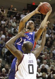 Kansas center Markieff Morris maneuvers to the bucket as Texas A&M forward Bryan Davis is called for a blocking foul during the first half, Monday, Feb. 15, 2010 at Reed Arena in College Station, Texas.