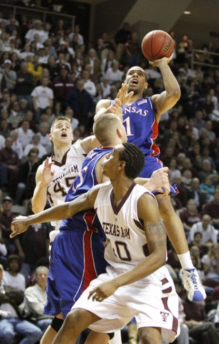 Kansas forward Xavier Henry rises above Texas A&M forwards Nathan Walkup (45), David Loubeau (10) and Kansas center Cole Aldrich for a shot during the second half, Monday, Feb. 15, 2010 at Reed Arena in College Station, Texas. Henry was fouled by Walkup on the play.