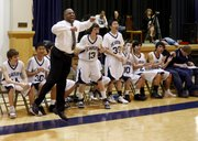 Seabury coach Mike Harding leads the bench in cheering during a third quarter scoring run that put the Seahawks ahead for good in Thursday's game against Cair Paravel.