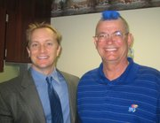 Cancer patient John Ross, sports a blue mohawk after losing a wager on KU football. His physician, Dr. Eston Schwartz, is at left.