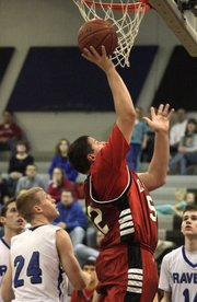 Senior Matthew Montes de Oca goes up for two points Friday, Feb. 19, 2010 during second half action of Lawrence High and Olathe Northwest boys basketball. The Lions lost 39-35.