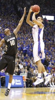 Kansas forward Xavier Henry pulls up for a three-pointer over Colorado guard Alec Burks during the first half, Saturday, Feb. 20, 2010 at Allen Fieldhouse.