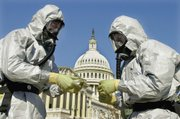 Members of the U.S. Marine Corps' Chemical-Biological Incident Response Force demonstrate anthrax cleanup techniques during a news conference Oct. 30, 2001, on Capitol Hill in Washington.
