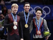 Gold medalist Evan Lysacek of the USA, center, silver medalist Evgeni Plushenko of Russia, left, and bronze medalist Daisuke Takahashi of Japan, right, pose on the podium during the medal ceremony for the men's figure skating competition Thursday at the Vancouver 2010 Olympics in Vancouver, British Columbia.