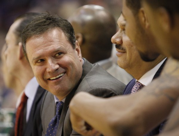 Kansas head coach Bill Self casts a smile down his bench in the second half, as the Jayhawks near victory against the University of Oklahoma on Feb. 22, 2010, in Allen Fieldhouse. Self participates in the Coaches vs. Cancer program. He encourages fans to participate in the American Cancer Society's 3-Point Attack contest during the NCAA tournament.