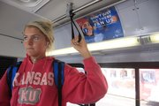 Kansas University freshman Olivia Banks, 18, Wichita, rides a KU on Wheels bus, which features a sign advising passengers to become a fan of the university on Facebook.