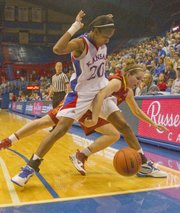 KU guard Sade Morris (20) works the base line against Iowa State's Alison Lacey (4) in the Jayhawks' 57-54 loss.