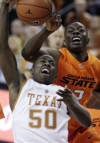 Oklahoma State guard Obi Muonelo, right, pressures Texas guard J'Covan Brown.