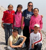 Peace Corps volunteer Elizabeth Durkin poses with her students while serving in Mongolia. Durkin taught health education at school and hospitals.
