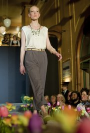 Caitlin Donnelly models clothes from the Social Service League as selected and styled by Katy Seibel, during the Spring Home & Garden Fashion Fundraiser Monday, March 1, 2010.
