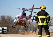 An air ambulance takes off after picking up a middle-aged man from the scene of a vehicle accident on Leavenworth County Road 25, just south of  Honey Creek Road. Kansas Highway Patrol officials at the scene of the accident said the man sustained minor to moderate injuries after his truck left the road and struck a tree.