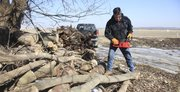 Mike Garrett gets ready to cut some firewood on his property at 1563 U.S. Highway 40.