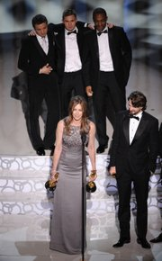 "Kathryn Bigelow accepts the Oscar for best motion picture of the year for ""The Hurt Locker"" at the 82nd Academy Awards on Sunday in Los Angeles. At right is screenwriter Mark Boal."