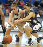 Connecticut's Caroline Doty, left, and Notre Dame's Skylar Diggins chase the ball. UConn won, 59-44, Monday in Hartford, Conn., for its NCAA-record 71st straight victory.