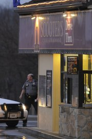 Police investigate a robbery Wednesday at Scooter's Coffeehouse, near Ninth and Iowa streets. A suspect held up two employees of the drive-through coffee shop at gunpoint Wednesday evening.