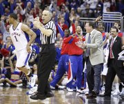 Kansas head coach Bill Self celebrates a three-pointer by forward Xavier Henry during the second half Thursday at the Sprint Center in Kansas City, Mo.