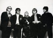 Barry Miles, left, John Dunbar, Marianne Faithfull, Peter Asher and Paul McCartney attend the opening of the Indica Gallery on Jan. 28, 1965.