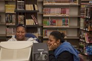From left, A'Shaune Edwards, 15, and Monica Edwards, 13, hang out in the Lawrence Public Library's Teen Zone, 707 Vt. As spring break begins and kids have extra time on their hands, consider a collection of book suggestions from the library staff.