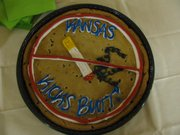 `Kansas kicks butt' was the message on a giant cookie at the ceremony where Gov. Mark Parkinson signed into law an indoor smoking ban.  The ban took effect July 1, 2010, and prohibits smoking at bars, restaurants and most indoor workplaces.