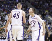 Kansas guard Brady Morningstar yells at his teammates to pick up the intensity during the second half March 12, 2010 in Kansas City, Mo.