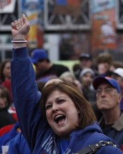 Kansas fan Kristina Love, El Dorado, pumps her fist as Jayhawk fans gather for a pregame pep rally prior to tipoff against Kansas State on Saturday in Kansas City, Mo.