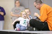 Addison Whitenight and her father, Jeffrey Whitenight, join the 2009 KU Dance Marathon.
