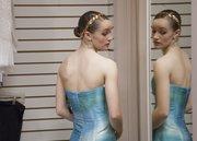 Elizabeth Arthaud, 17, Chula, Mo.,  considers a prom dress Saturday at Weaver's.