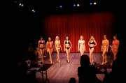 Miss Lawrence/Miss Leavenworth County contestants, from left, Jennifer Long, Ashley Crane, Chandler Mann, Kimberly Fuller, Taylor Ford, Megan Bancroft, Cachet Hancock and Cassi Reimer, model during the fitness in swimsuit portion of the competition on Saturday, March 13, 2010, at the Lawrence Community Theater.