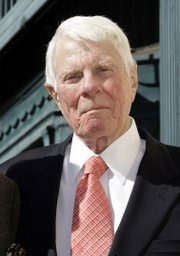 Peter Graves attends dedication ceremonies for his star on the Hollywood Walk of Fame in Los Angeles in this Oct. 30, 2009, file photo. According to a publicist, Graves has died in Los Angeles. He was 83.