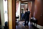 David Charles, stylist at Headmasters Salon, colors the hair of client Bridget Patti, Lawrence.