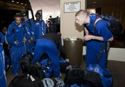 Kansas center Cole Aldrich, right, and C.J. Henry, left, wade among the luggage as it is set down along the drive outside the Sheraton Hotel in downtown Oklahoma City, Tuesday, March 16, 2010. The team arrived Tuesday evening and is scheduled to practice at 5:10 p.m. Wednesday at the Ford Center.