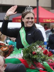 Queen Katlin Affalter waves at the crowd Wednesday during the 23rd annual Lawrence St. Patrick's Day Parade.