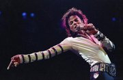Michael Jackson performs during his 13-city U.S. tour in Kansas City, Mo., in this Feb. 24, 1988, file photo. Jackson's estate has landed the late King of Pop the biggest recording deal in history: a $200 million guaranteed contract with Sony Music Entertainment for 10 projects over seven years, according to a person familiar with the deal.