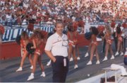 Dr. Ken Wertzberger, a Lawrence orthopedic surgeon, is pictured at a Kansas University football game in California in the early 80s, when he first began volunteering to watch over Kansas University athletes. He spent 27 years helping athletes and was honored for his service in February.