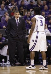 Kansas State head coach Frank Martin has words for KSU guard Martavious Irving as he leaves the court during the first half Thursday, March 18, 2010 at the Ford Center in Oklahoma City.