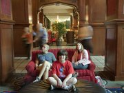 The Skirvin Hilton hotel in Oklahoma City is allegedly haunted, but KU graduates Todd and Andrea Jones and their son Carter, 9, Overland Park, are feeling lucky to be following the Jayhawks. The Jones family is pictured Friday, March 19, 2010 in the lobby of the Skirvin.