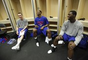 Kansas teammates Brady Morningstar, left, Thomas Robinson and Elijah Johnson have a laugh in the locker room at the Ford Center, Friday, March 19, 2010 in Oklahoma City.