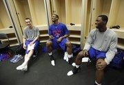 Kansas teammates Brady Morningstar, left, Thomas Robinson and Elijah Johnson have a laugh in the locker room at the Ford Center, Friday, March 19, 2010 in Oklahoma City.