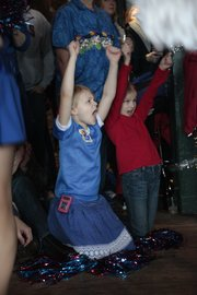 Two young Jayhawk fans join the cheerleaders in a cheer during the KU Alumni Association pep rally at Bricktown Brewery Saturday, March 20, 2010.