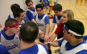 Lori McSorley, second from right, talks with her team of Jayhawks with the Douglas County Special Olympics during a break in action at the Special Olympics State Basketball and Cheerleading Tournament in 2010 in Hays. Five teams in all competed in the basketball event.