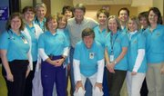 John Ross meets with some of the members of the Lawrence Memorial Hospital oncology staff wearing shirts that he bought for the group in this 2008 photo. He also handed out wrist bands that read Rossie Posse.