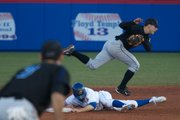 KU's Brian Heere slides under a Creighton infielder safely into second base during the game on Tuesday, March 23, 2010.
