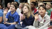 Sunflower School second-graders, from left, Trevor Arellano, Morgan Marsh and Hatoon Barn are a rapt audience during the presentation by Eudora high school students.