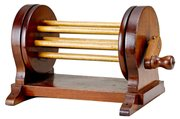 """Only a fisherman would know that this is a mahogany line dryer. The 8 1/2-inch-wide spool with wooden spindles sold for $590 at an auction held by Lang's Sporting Collectables of Waterville, N.Y. The silver foil label with the initials """"A & F"""" (for Abercrombie & Fitch) added to the value."""